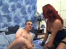 Redheaded shemale and guy suck each other dicks