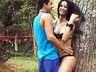 Guy caresses and blows sexy brunette tranny outdoors