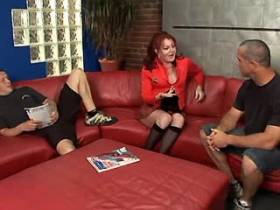 Redhead busty shemale gets blowjob from two guys