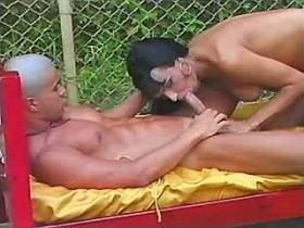 Guy jumps on cock of cute shemale and jizzes outdoor