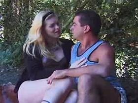 Blonde shemale sucks and fucks from behind outdoor
