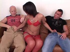 Brunette tranny and two guys suck cocks each other